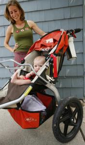 Sylvie McCavanagh rides in style in her Bob stroller that costs $450. Her mom, Emily, says it was an investment.