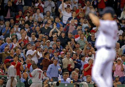 An appreciative Fenway Park crowd applauds the decision to let Josh Beckett take the mound for the ninth to complete his four-hit masterpiece.