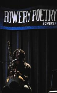 Kurt Lamkin performs an improvisational jam with a West African kora, a 21-string harp-lute, at the Bowery Poetry Club.