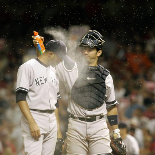 The bugs at Jacobs Field swarmed Mariano Rivera, who got a little relief from catcher Jorge Posada in the ninth.