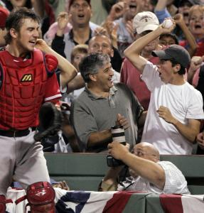 Jeff Mathis (left) was beaten to a foul ball by Sox fan Danny Vinik (right), who plucked the ball before it hit the catcher's mitt.