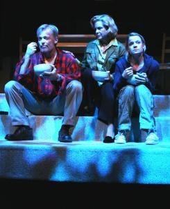 Allyn Burrows, Monique Fowler (center), and Amelia McClain as parents and daughter in 'The Pursuit of Happiness' at Merrimack Repertory Theatre.