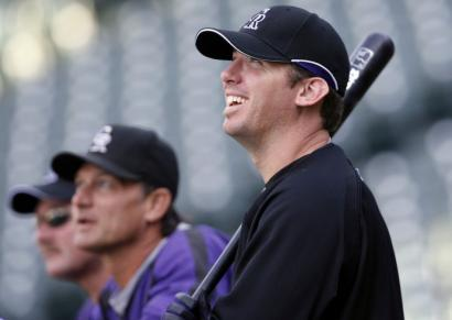 The Rockies' Garrett Atkins, at a workout yesterday, became a lot more potent with a bat in his hands this season after changing his approach and going to the opposite field more.