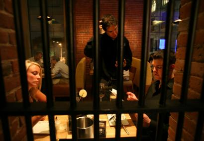 Sarah Russo and David Donlan check out Clink., the Liberty Hotel's restaurant in the old Charles Street Jail.
