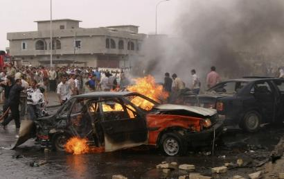 A crowd gathered in a marketplace in the northern Iraq city of Kirkuk yesterday at the scene of a car-bomb attack that killed at least seven people and wounded 50 others; it was one of several suicide bombings across the country, with the death toll reportedly reaching 35.