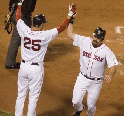 Kevin Youkilis gets a hand from Mike Lowell after scoring in the first. Youkilis crossed the plate twice more on the night.