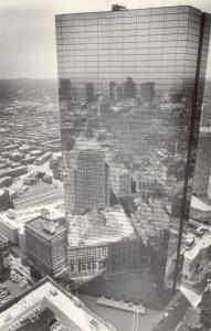 The windows of Boston's John Hancock Building act as mirrors in daylight.