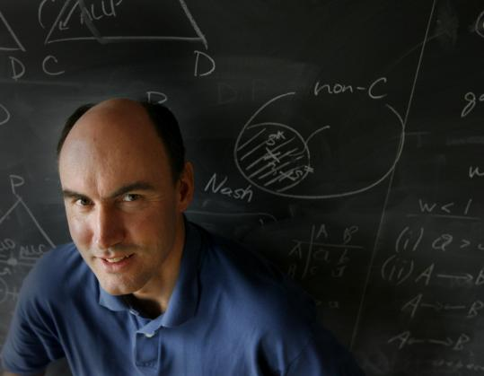 Martin Nowak formulates mathematical equations to understand evolutionary forces.