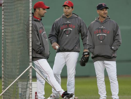 Terry Francona had a chance prior to Game 2 at Fenway to chat with his designated Game 4 starter, Tim Wakefield (left), and Josh Beckett, who will pitch on five days' rest in Game 5.