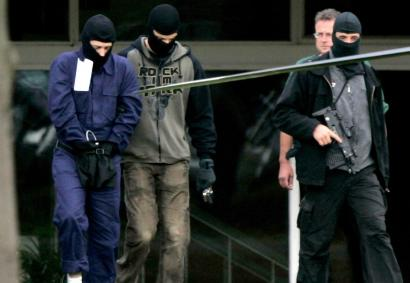 Antiterror specialists say suspected militants, such as the person (left) escorted by German police and accused last month of plotting against US facilities, have ties to camps in Pakistan.