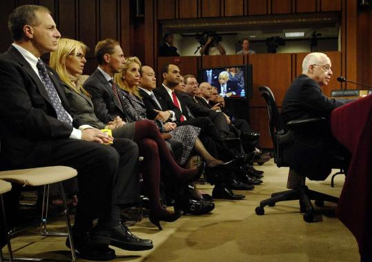 Louis Freeh (left), the former FBI director, sat with Michael Mukasey's family and other supporters yesterday as the nominee answered questions from the Senate Judiciary Committee. The confirmation hearing is scheduled to continue today.