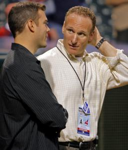 The Red Sox' Theo Epstein (left) and the Indians' Mark Shapiro indulge in some GM talk before Game 5.