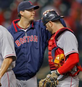 Red Sox ace Josh Beckett gives a pat to catcher Jason Varitek after beating the Indians for the second time in the ALCS.