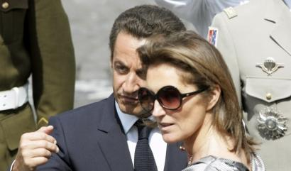 President Nicolas Sarkozy and his wife, Cecilia, talked during Bastille Day celebrations in Paris on July 14.