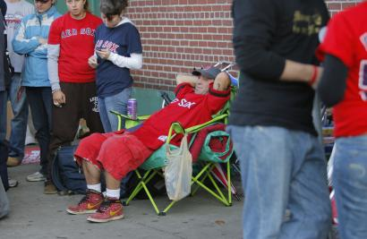 Dave Millette, a veteran of ticket lines, appears to be enjoying the satisfaction of being first in line for Red Sox ducats for last night's Game 6 of the ALCS.