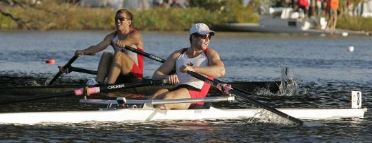 Malcolm Howard (left) rows under the Eliot Bridge and past Kevin Light on his way to his single's title.