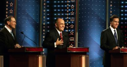 Former Arkansas governor Mike Huckabee (left) laughed along with Rudy Giuliani (center) and Mitt Romney last night. Several other candidates expressed frustration that Republicans were using the national stage to tear down fellow candidates.