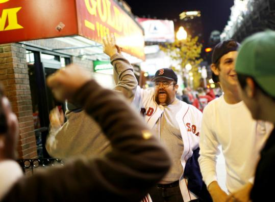 Mike Passalaqua of Scituate cheered during the fifth inning outside of Fenway Park last night. 'This is great for the city,' Mayor Thomas M. Menino said after the game.