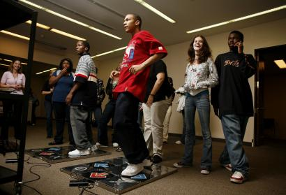 Leon Shaw, 15, of Boston competed with friends during a Dance Dance Revolution Tournament at the Boston Public Library on Friday.