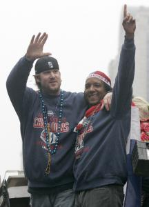 In their last official acts as Sox, Derek Lowe and Pedro Martínez took a ride in the rolling rally.