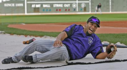 Once out of the the visitors' locker room at Fenway Park, Rockies catcher Yorvit Torrealba got to stretch his legs during batting practice yesterday.