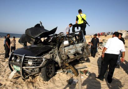 Mubarak al-Hassanat, 37, was driving on Gaza's coastal road yesterday when his vehicle was hit by missiles.