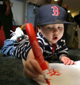Mikalo Glennon, 2, added his touch as patients at the Dana-Farber Cancer Institute made banners to cheer the Sox yesterday.