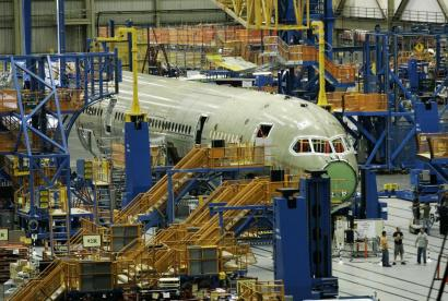 A six-month delay in delivering the new 787 Dreamliner prompted Boeing Co. to cut next year's projected shipments by up to 40 planes, or 7.7 percent. The 2008 profit outlook is unchanged, Chicago's Boeing said.