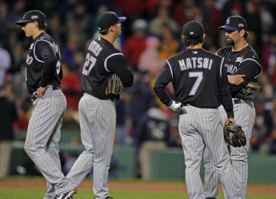 This was a familiar pose for the Rockies' infield as they awaited a pitching change in the Red Sox' 13-batter, seven-run fifth.