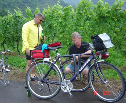 Ben Terkanian waits as Wilhelm Benden, the tour guide, fixes a flat tire.