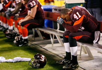 Linebacker Cam Martin (41) and the rest of the Hokies are a shocked bunch as the game ends.
