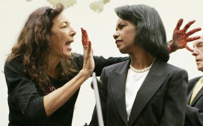 Secretary of State Condoleezza Rice confronted by a protester, Desiree Fairooz of Texas, in Washington on Wednesday.