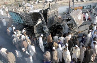 Residents of Swat, Pakistan, viewed the wreckage yesterday from Thursday's bombing that killed 20 and wounded 35.