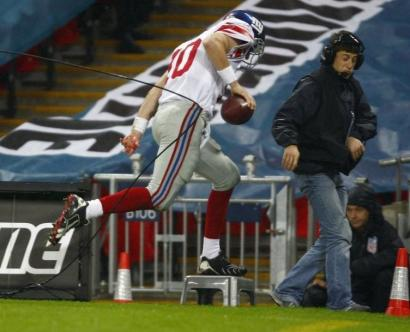 The NFL's first game overseas was bound to hit some snags, like Eli Manning getting tangled in a cable after a rushing TD.