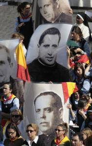 Students from Compania de Maria school in Talavera de la Reina, Spain, held portraits of clergy members killed during Spain's Civil War at the Vatican yesterday. It was the largest beatification ceremony in church history, putting 498 Catholics slain in the war on the path to sainthood.