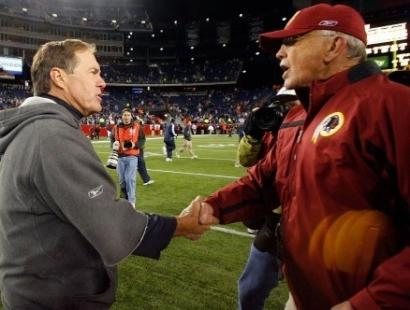 Bill Belichick (left) and Joe Gibbs shake hands after the Patriots handed the Redskins a trouncing.