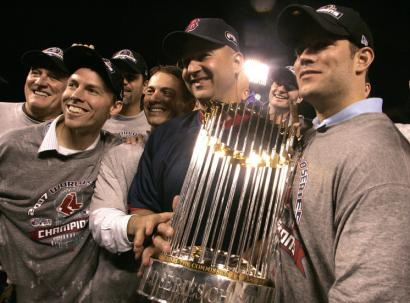 Red Sox general manager Theo Epstein (right) and Terry Francona strike a pose with the World Series trophy.