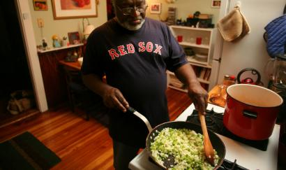 'Picnic on the Moon' author Charles Coe (preparing spicy chicken stew in his Cambridge home) has written a cycle of haikus about his mess sergeant father's pot roast.