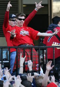 Red Sox pitchers Jonathan Papelbon (foreground) and Mike Timlin celebrated as they rolled past City Hall on a flatbed truck.