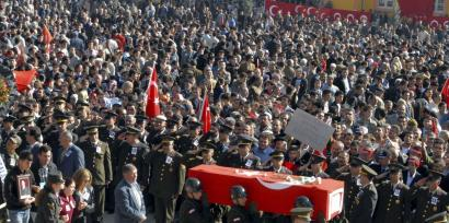 Thousands of people yesterday attended the funeral in Yozgat, Turkey, of Ilyas Karadavut, a soldier killed by Kurdish rebels in an ambush last month.