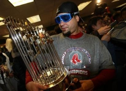 Manny Delcarmen admired the World Series trophy after Game 4.