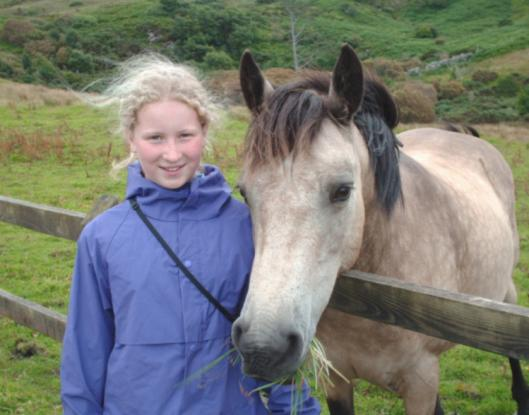 Katie Carpenter, 11, with a Connemara pony in Connemara National Park in County Galway.
