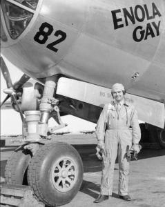 Paul W. Tibbets, beside the B-29 Superfortress bomber the Enola Gay.