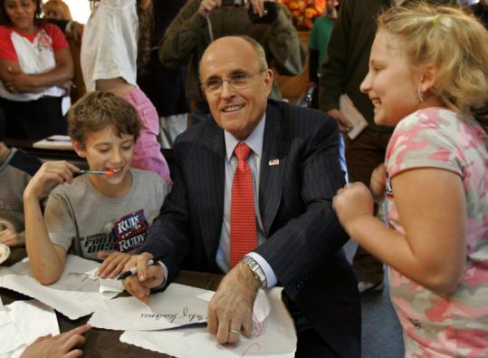 Presidential contender Rudy Giuliani signed autographs yesterday for Mikey McKinney and Kailen Lemieux in Errol, N.H.