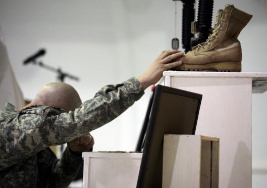A US Army soldier paid respects in Mosul yesterday after Captain Timothy McGovern, of Idaville, Ind., and Specialist Brandon Smitherman, of Conroe, Texas, were killed by a bomb.