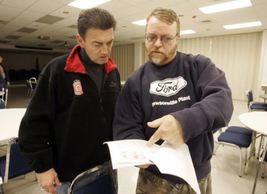 Two United Auto Workers officials, Richard Greenfield (left) and Jim Pedersen talked at the union office in Wayne, Mich.