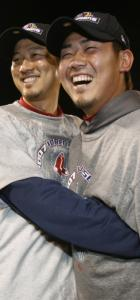 Hideki Okajima (left) and Daisuke Matsuzaka stuck with each other after helping to bring home a Series title.