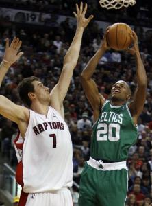Ray Allen, who had 33 points (many from long distance), takes Andrea Bargnani (left) to the hoop for 2 in the paint.