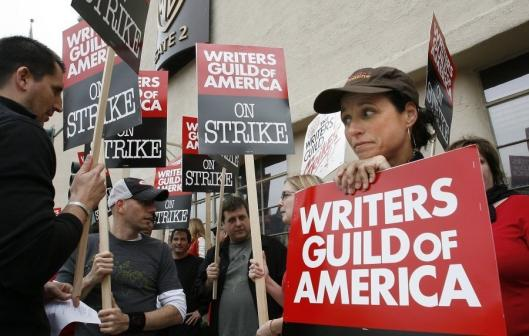 Julia Louis-Dreyfus lends her support to Writers Guild of America members as they picket Warner Bros. studios in Burbank, Calif., yesterday.