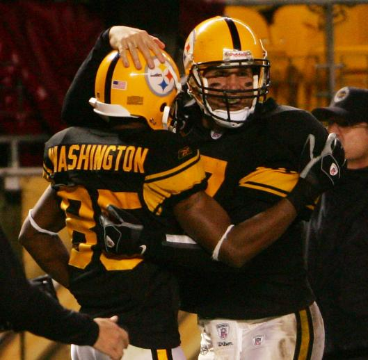 Ben Roethlisberger congratulates Nate Washington after he hauled in one of the quarterback's five TD passes.